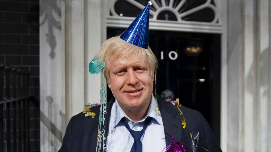FILE - In this photo taken Friday, May 4, 2012 file photo, Madame Tussauds London mark Boris Johnson's victory in the London mayoral election by giving him a post-party makeover. Britain's new top diplomat is shaggy-haired, Latin-spouting Boris Johnson, who in recent months has made insulting and vulgar comments about the presidents of the United States and Turkey. (AP Photo/Jonathan Short, File)