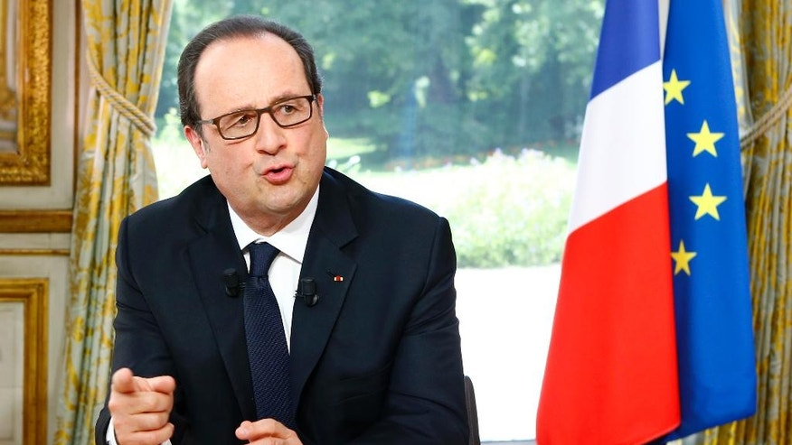 French President Francois Hollande gestures  after a televised interview following the Bastille Day Parade in Paris, Thursday, July 14, 2016 at the Elysee Palace. (AP Photo/Francois Mori, Pool)