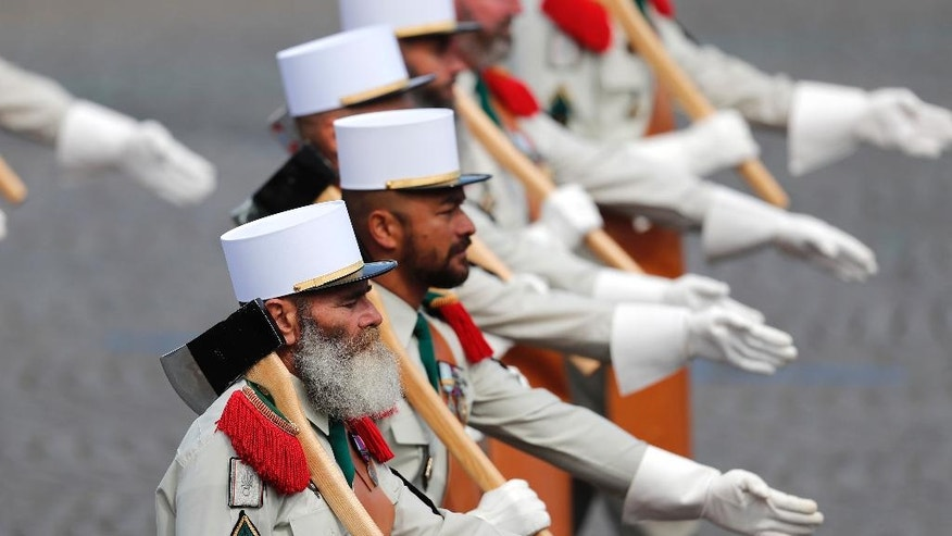 Foreign Legion soldiers parade on the Champs Elysees avenue during the Bastille Day paradeThursday, July 14, 2016 in Paris.  (AP Photo/Francois Mori)