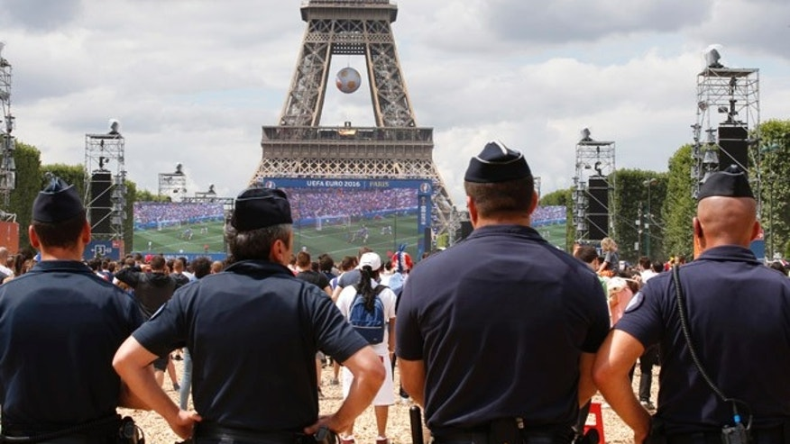 FILE: French gendarmes maintain security near the Eiffel Tower during a soccer match in Paris.