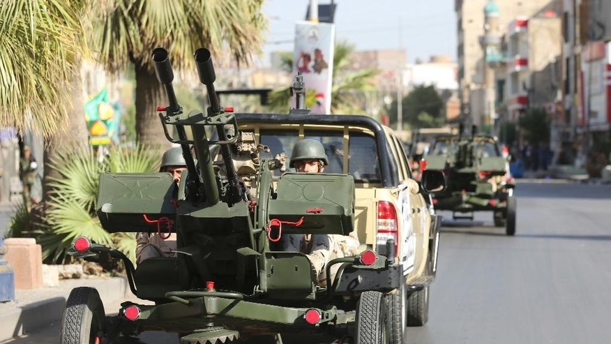 Iraqi security forces parade in Baghdad, Iraq, Thursday, July 14, 2016. Iraq on Thursday marked the anniversary of the 1958 overthrow of the monarchy and recent victories over the extremist Islamic State group with a military parade staged in central Baghdad amid tight security. (AP Photo/Hadi Mizban)
