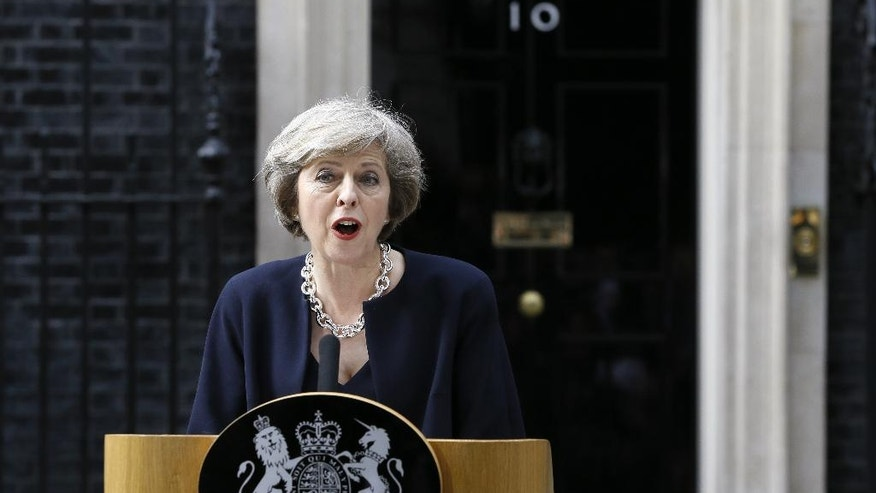 New British Prime Minister Theresa May speaks to the media outside her official residence,10 Downing Street in London, Wednesday July 13, 2016. David Cameron stepped down Wednesday after six years as prime minister. (AP Photo/Kirsty Wigglesworth)