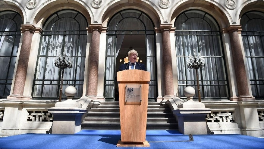 Foreign Secretary Boris Johnson addresses staff inside the Foreign Office in London, Thursday July 14, 2016, as new British Prime Minister Theresa May continues to fill more Cabinet posts Thursday. (Andrew Matthews/Pool via AP)
