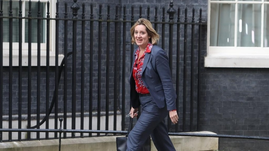 Amber Rudd arrives at 10 Downing Street to meet with new Prime Minister Theresa May, in London, Wednesday, July 13, 2016.  Rudd has been appointed Home Secretary by new Prime Minister Theresa May. (Steve Parsons/PA via AP)