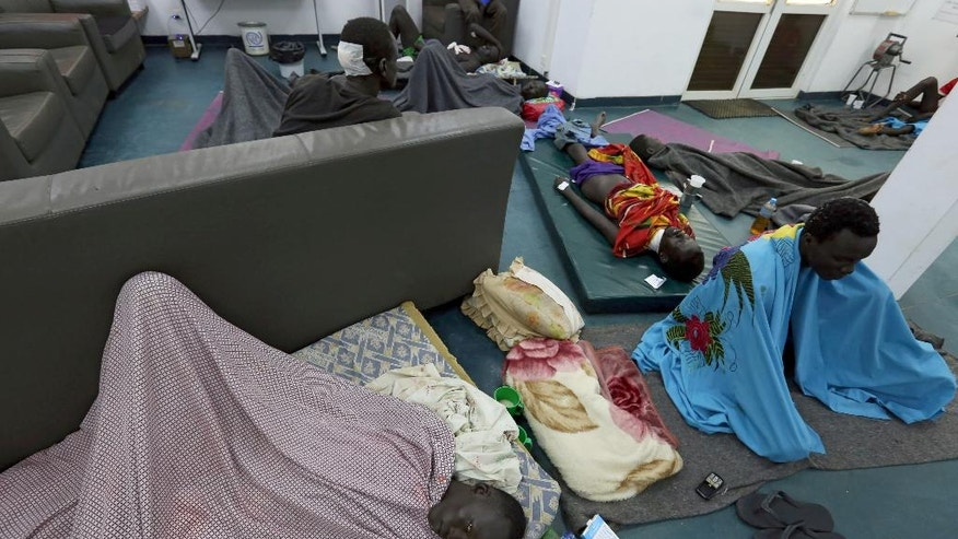 In this photo taken Wednesday, July 13, 2016 and released by the United Nations Mission in South Sudan (UNMISS), Internally Displaced People (IDP's) and villagers take shelter at UN hospital in the capital Juba, South Sudan. The death toll from a recent outbreak of fighting in South Sudan is almost certain to climb above the 272 people, including 33 civilians, reported by the government, United Nations officials said Wednesday (Eric Kanalstein/UNMISS via AP)
