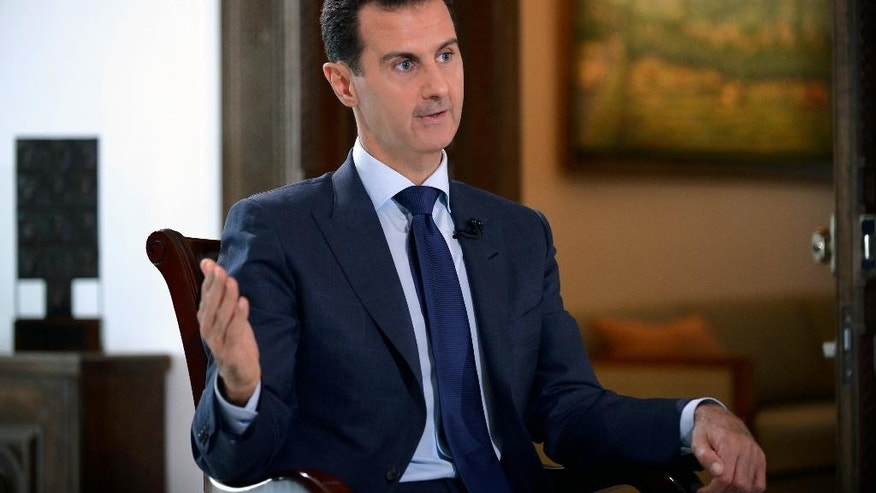 In this photo released on Thursday, July 14, 2016, by the Syrian official news agency SANA, Syrian President Bashar Assad, speaks during an interview with American network NBC News, in Damascus, Syria. Assad said he does not know who killed U.S.-born journalist Marie Colvin, whose relatives have filed a lawsuit in U.S. federal court claiming that Syrian government officials targeted and killed her in 2012 to silence her reporting on Syria and the besieged city of Homs. (SANA via AP)