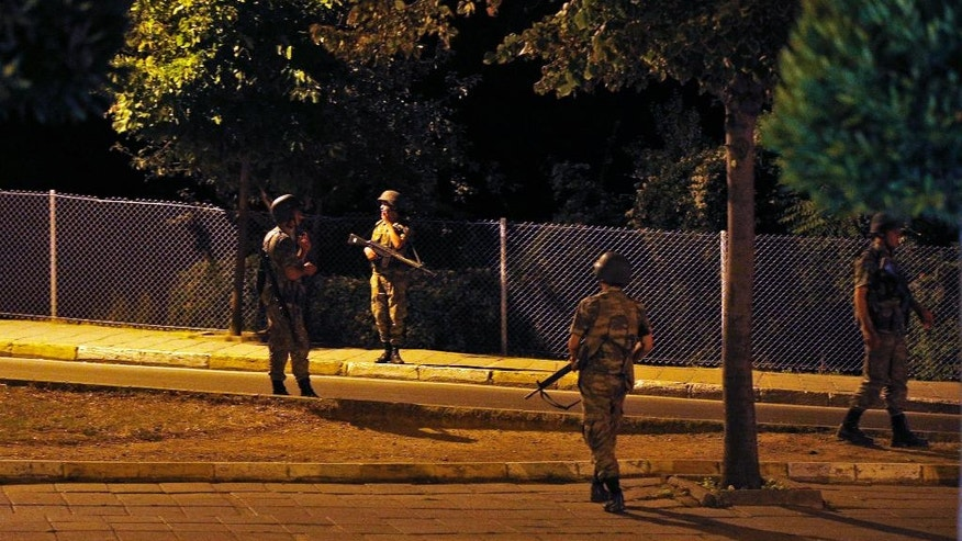 "Turkish soldiers are seen on the Asian side of Istanbul, Friday, July 15, 2016. A group within Turkey's military has engaged in what appeared to be an attempted coup, the prime minister said, with military jets flying over the capital and reports of vehicles blocking two major bridges in Istanbul. Prime Minister Binali Yildirim told NTV television: ""it is correct that there was an attempt,"" when asked if there was a coup. (AP Photo/Emrah Gurel)"