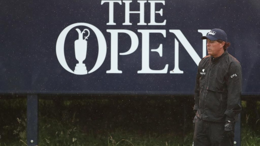 Phil Mickelson of the United States looks at his chip onto the 9th green during the second round of the British Open Golf Championships at the Royal Troon Golf Club in Troon, Scotland, Friday, July 15, 2016. (AP Photo/Peter Morrison)