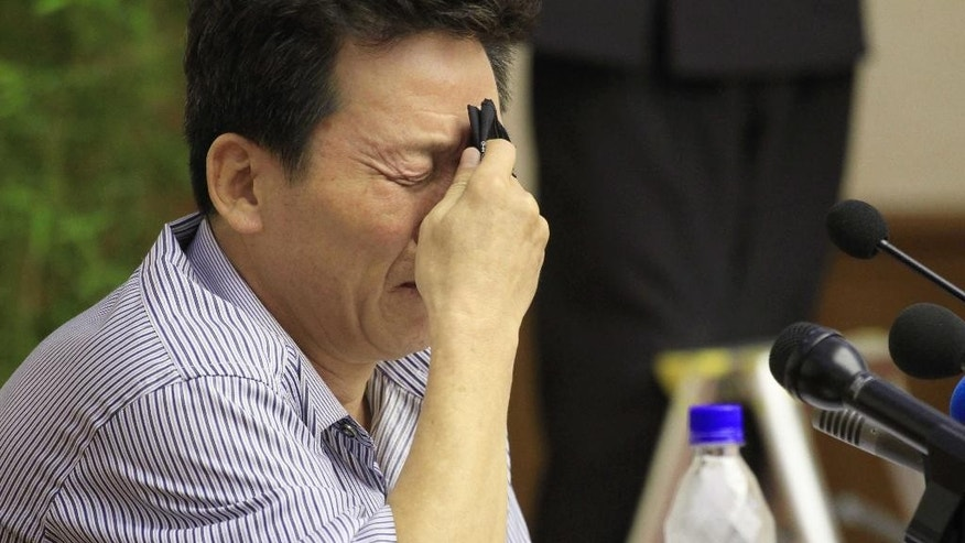 Ko Hyon Chol is overcome with emotion as he is presented to reporters in Pyongyang, North Korea, on Friday, July 15, 2016. North Korea on Friday presented Ko Hyon Chol as a man it alleges is a South Korean spy who tried to enter the North to kidnap children. (AP Photo/Jon Chol Jin)