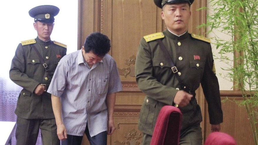Ko Hyon Chol, center, is presented to reporters in Pyongyang, North Korea, on Friday, July 15, 2016. North Korea on Friday presented Ko Hyon Chol as a man it alleges is a South Korean spy who tried to enter the North to kidnap children. (AP Photo/Jon Chol Jin)