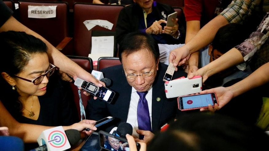 "New Philippine Solicitor General Jose Calida talks to the media during a break in the forum on Tuesday's ruling by the Hague-based UN international arbitration tribunal favoring the Philippines in its case against China on the dispute in South China Sea Friday, July 15, 2016 in suburban Quezon city, northeast of Manila, Philippines. The tribunal has found that there is no legal basis for China's ""nine-dash line"" claiming rights to much of the South China Sea. The tribunal issued its ruling Tuesday, July 12, 2016 in The Hague in response to an arbitration case brought by the Philippines against China. (AP Photo/Bullit Marquez)"