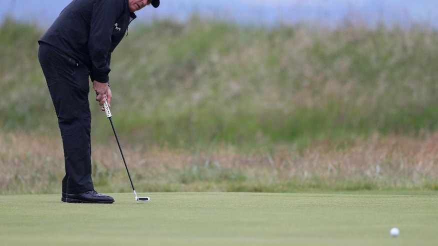Phil Mickelson of the United States putts on the 1st green during the second round of the British Open Golf Championship at the Royal Troon Golf Club in Troon, Scotland, Friday, July 15, 2016. (AP Photo/Peter Morrison)