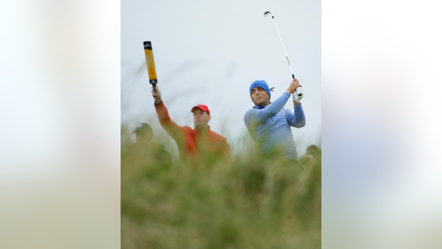 Francesco Molinari of Italy tees off the 7th  during the second round of the British Open Golf Championship at the Royal Troon Golf Club in Troon, Scotland, Friday, July 15, 2016. Molinari is wearing a black ribbon on his hat to show sympathy with the attack in Nice, France, on Thursday.(AP Photo/Matt Dunham)