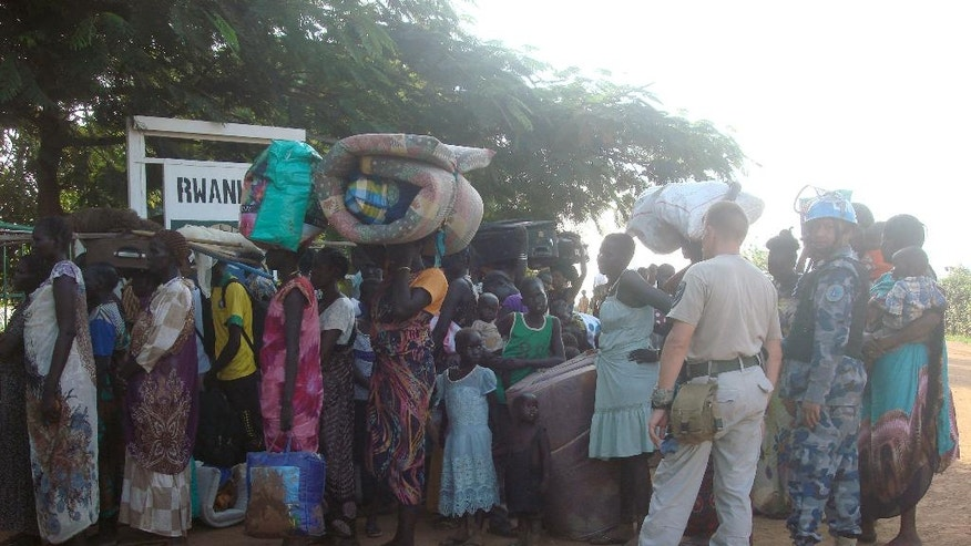 In this photo taken Thursday, July 14, 2016 and released by the United Nations Mission in South Sudan (UNMISS), people queue to seek protection at the UN camp in Juba, South Sudan. Some South Sudanese, even those with dual U.S. citizenship, are not being allowed to leave the country, even as the United States, India and other countries continued Thursday to evacuate their citizens while a fragile cease-fire appeared to hold. (Beatrice Mategwa/UNMISS via AP)