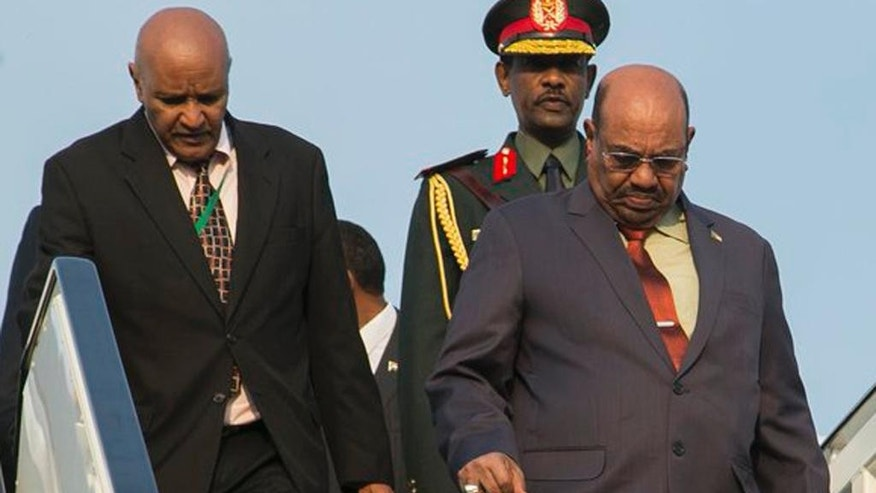 Sudan president Omar al-Bashir, right, arrives in Kigali, capital of Rwanda, Saturday, July 16, 2016. Al-Bashir arrived in Rwanda to attend a summit of African leaders, defying an international warrant of arrest after public assurances from Rwandan leaders that he would not be arrested. (AP Photo/Ssuuna katera)