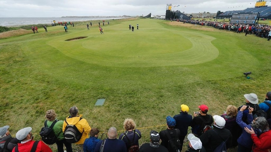 Crowd watch as Jason Day of Australia and David Howell of England play the 2nd green during the third round of the British Open Golf Championships at the Royal Troon Golf Club in Troon, Scotland, Saturday, July 16, 2016. (AP Photo/Ben Curtis)