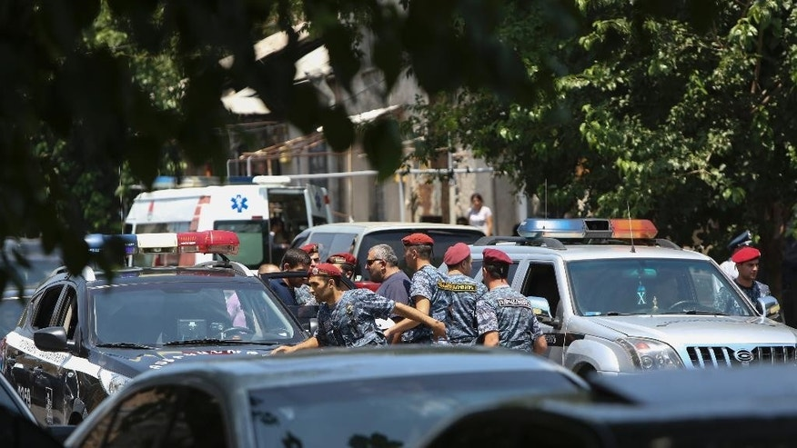 Armenian police and special forces secure the area around a police station in Yerevan, Armenia, Sunday, July 17, 2016. Armenia security forces say a group of armed men has attacked a central police station in the Armenian capital, killing one officer, wounding two and taking others hostage. (Varo Rafayelyan/PAN Photo via AP)