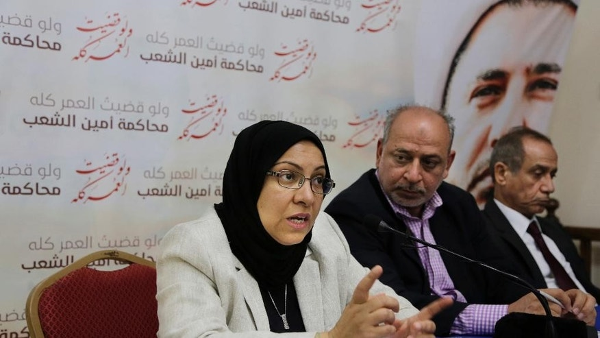 FILE - In this Monday, May 30, 2016, file photo lawyer Jalila al-Sayed, left, speaks to journalists as Abduljalil Khalil, a senior member of Al-Wefaq political society, center, and lawyer Hassan Radhi, right, listen during a press conference in Manama, Bahrain.  Local media in Bahrain are reporting that a court has ordered the country's main Shiite opposition group to be dissolved. The order against Al-Wefaq follows an intensified crackdown on dissent in the Sunni-ruled island kingdom, which is home to the U.S. Navy's 5th Fleet. (AP Photo/Hasan Jamali)