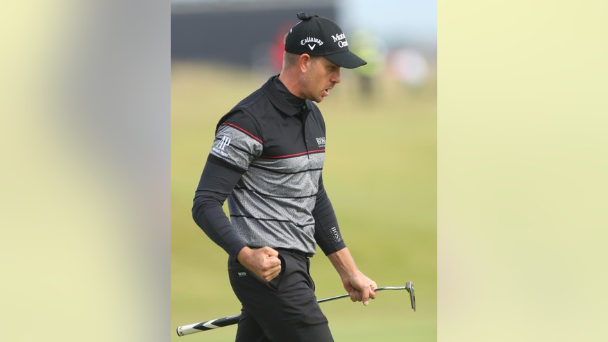 Henrik Stenson of Sweden reacts after making a birdie putt on the 15th green during the final round of the British Open Golf Championship at the Royal Troon Golf Club in Troon, Scotland, Sunday, July 17, 2016. (AP Photo/Peter Morrison)