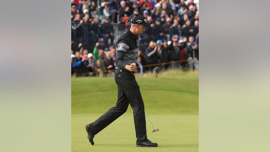 Henrik Stenson of Sweden celebrates after getting a birdie on the 14th green during the final round of the British Open Golf Championship at the Royal Troon Golf Club in Troon, Scotland, Sunday, July 17, 2016. (AP Photo/Peter Morrison)