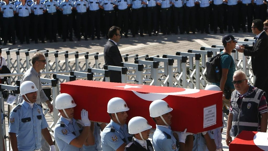 Turkish honor guards carry the coffin of a policeman killed Friday during the failed military coup, during a mass funeral in Ankara, Turkey, Sunday, July 17, 2016. The Turkish government accelerated its crackdown on alleged plotters of the failed coup against President Recep Tayyip Erdogan, with the justice minister saying Sunday that 6,000 people had been detained in the investigation, including three of the country's top generals and hundreds of soldiers. (AP Photo/Hussein Malla)