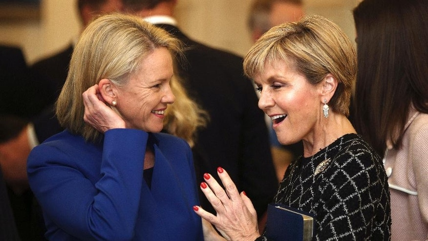 Australia's Foreign Minister Julie Bishop, right, and Minister for Regional Development Fiona Nash chat before being sworn in at Government House in Canberra, Australia, Tuesday, July 19, 2016. Australia's new cabinet was sworn in Tuesday, but the conservative government will have the slimmest of majorities when Parliament opens next month. (AP Photo/Rob Griffith)