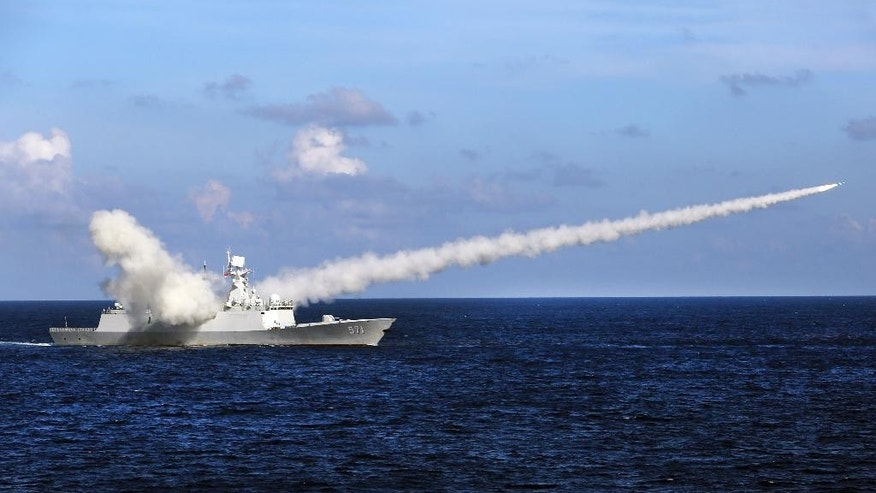 FILE - In this July 8, 2016, file photo released by Xinhua News Agency, Chinese missile frigate Yuncheng launches an anti-ship missile during a military exercise in the waters near south China's Hainan Island and Paracel Islands. China said Monday, July 18, 2016, that it is closing off a part of the South China Sea for military exercises this week, days after an international tribunal ruled against Beijing's claim to ownership of virtually the entire strategic waterway. Hainan's maritime administration said an area southeast of the island province would be closed from Monday to Thursday, but gave no details about the nature of the exercises. (Zha Chunming/Xinhua via AP, File)