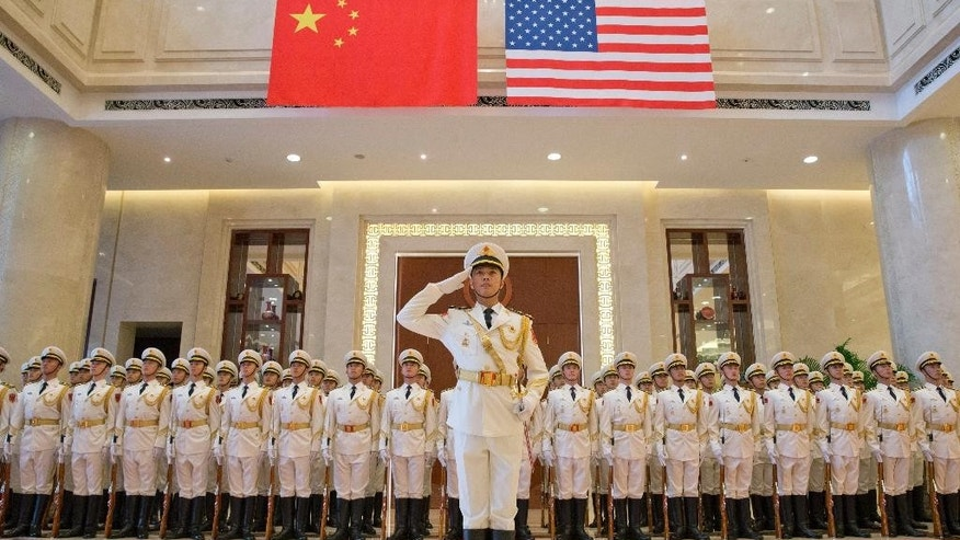 A navy honor guard prepares for a welcome ceremony for U.S. Chief of Naval Operations Adm. John Richardson at the Chinese Navy Headquarters in Beijing, Monday, July 18, 2016. (AP Photo/Ng Han Guan, Pool)