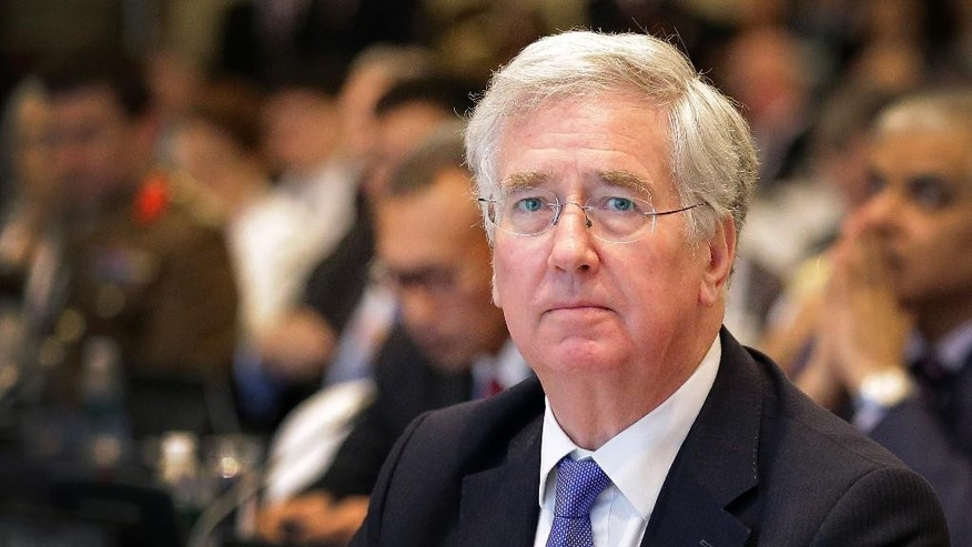 FILE - This is a Saturday, June 4, 2016  file photo of British Defense Secretary Michael Fallon as he attends the 15th International Institute for Strategic Studies Shangri-la Dialogue, or IISS, Asia Security Summit  in Singapore. Michael Fallon said Monday July 18, 2016 that Britain will have to work harder to maintain its military and political influence on the global stage after it leaves the European Union.  (AP Photo/Wong Maye-E, File)