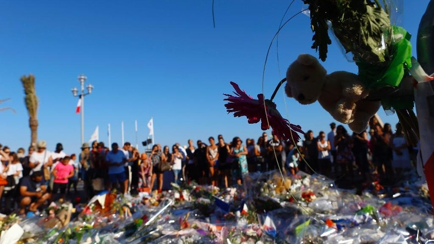 on the famed Promenade des Anglais in Nice, southern France, three days after a truck mowed through revelers, Sunday, July 17, 2016. French authorities detained two more people Sunday in the investigation into the Bastille Day truck attack on the Mediterranean city of Nice that killed at least 84 people, as authorities try to determine whether the slain attacker was a committed religious extremist or just a very angry man.(AP Photo/Francois Mori)