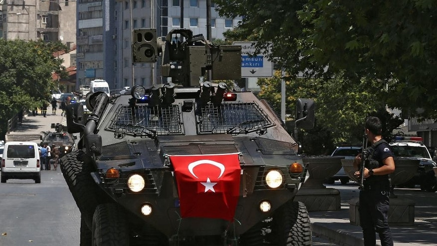 A Turkish police special forces APC arrives at the scene where the Ankara governor's office says a military officer was detained after he shot and killed the driver of a vehicle that he hijacked, at Ulus district in Ankara, Turkey, Monday, July 18, 2016. In a brief statement Monday, the governor's office said the officer whom it described as being mentally disturbed was caught by the security forces following a brief shoot out.  (AP Photo/Hussein Malla)