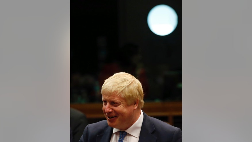 Newly appointed British Foreign Secretary Boris Johnson smiles before a meeting of EU foreign ministers at the EU Council building, in Brussels, Belgium, Monday, July 18, 2016. Johnson, who recently likened the European Union to Adolf Hitler's vision for Europe, is in Brussels to meet with his new EU colleagues, and says he hopes to cooperate closely. (AP Photo/Darko Vojinovic)