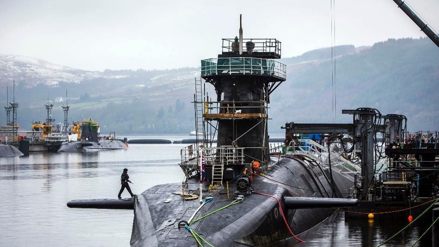 FILE - This Jan. 20, 2016 file photo shows the Vanguard-class submarine HMS Vigilant, one of four Royal Navy submarines armed with Trident missiles, at HM Naval Base Clyde, also known as Faslane, Scotland. British lawmakers are due to vote Monday July 18, 2016, on whether to replace the country's fleet of nuclear-armed submarines, a powerful but expensive symbol of the country's military status. (Danny Lawson/PA via AP)