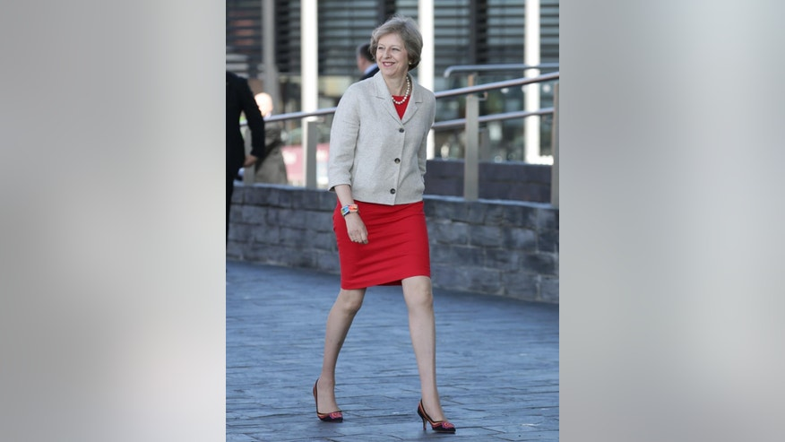 Britain's Prime Minister Theresa May arrives at the National Assembly for Wales building in Cardiff,  Wales for a bilateral meeting with the First Minister of Wales, Carwyn Jones Monday July 18, 2016. ( Yui Mok/PA via AP)