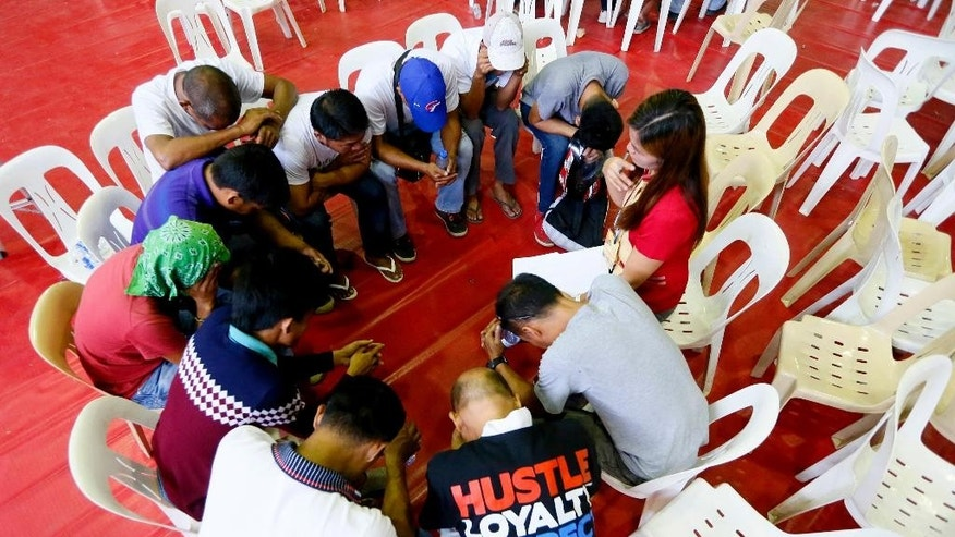 Residents undergo counseling after heeding a call of Tanauan Mayor Antonio Halili to undergo processing allegedly for being drug-users Monday, July 18, 2016 at Tanauan city, Batangas province, south of Manila, Philippines. Philippine President Rodrigo Duterte said he plans to ask Chinese officials why some Chinese citizens who visit his country are involved in illegal drugs. The crime-fighting President, who has vowed to end crimes within six months of taking office on June 30, also said that he will not hesitate to grant pre-signed presidential pardons to law enforcers accused by human rights advocates of abusing their authority in cracking down on narcotics, as long as the soldiers and police involved tell the truth and do not fabricate evidence. (AP Photo/Bullit Marquez)
