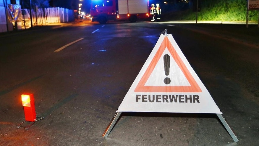 A firetruck blocks a road in Wuerzburg, southern Germany, Monday evening, July 18, 2016. A man attacked people in a train and injured more than a dozen. (Karl-Josef Hildenbrand/dpa via AP)