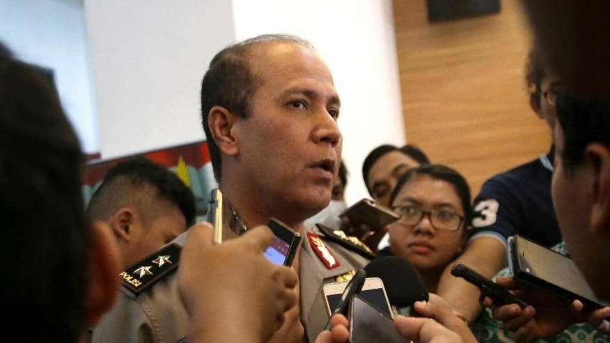 Indonesian National Police spokesman Maj. Gen. Boy Rafli Amar speaks to the media after a press conference at the National Police headquarters in Jakarta, Indonesia, Tuesday, July 19, 2016. Two suspected militants were killed Monday in the shootout in a remote jungle area of Sulawesi where security forces have been pursuing the country's most wanted Islamic militant Santoso and his followers for months. (AP Photo/Tatan Syuflana)