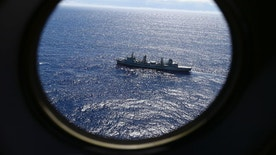 "FILE - In this March 31, 2014 file photo, HMAS Success, as seen from a Royal New Zealand Air Force P3 Orion, patrols the Indian Ocean searching for the missing Malaysia Airlines Flight 370 off the coast of Western Australia. Investigators in Australia on Monday, July 18, 2016, were examining a wing flap found in June on an East African island that is suspected to be from the missing Malaysian airliner, officials said. The ""large piece of aircraft debris"" arrived at the Australian Transport Safety Bureau headquarters in the capital, Canberra, for examination as part of the search for Malaysia Airlines Flight 370, said a joint statement by Australian and Malaysian government authorities. (AP Photo/Rob Griffith, File)"