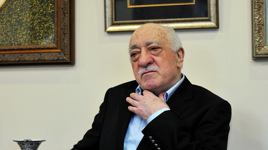 Islamic cleric Fethullah Gulen speaks to members of the media at his compound, Sunday, July 17, 2016, in Saylorsburg, Pa. Turkish officials have blamed a failed coup attempt on Gulen, who denies the accusation. (AP Photo/Chris Post)