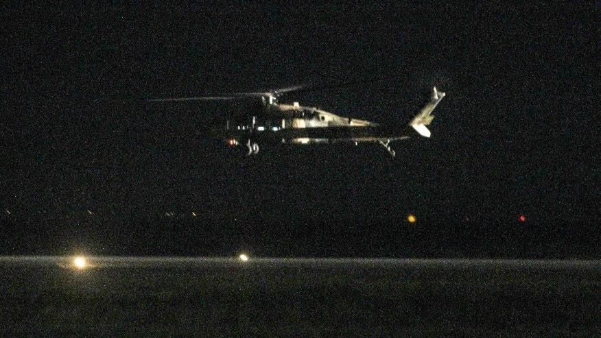 A Turkish Blackhawk helicopter takes off from the airport of Alexandroupolis, northern Greece, Sunday, July 17, 2016. A Blackhawk military helicopter with seven Turkish military personnel and one civilian landed in the Greek city of Alexandroupolis, where the passengers requested asylum. While Turkey demanded their extradition, Greece said it would hand back the helicopter and consider the men's asylum requests. (Giannis Moιsiadis/InTime News via AP)