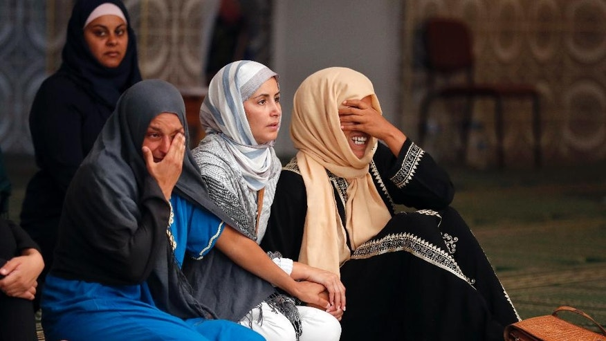 Relatives of 4 year old Kylan Mejri who was killed in Thursday's truck attack, cry at the ar-Rahma mosque in the eastern Nice suburb of Ariane, Tuesday, July 19, 2016. Kylan's mother Olfa Kalfallah, 31, was also killed. (AP Photo/Francois Mori)