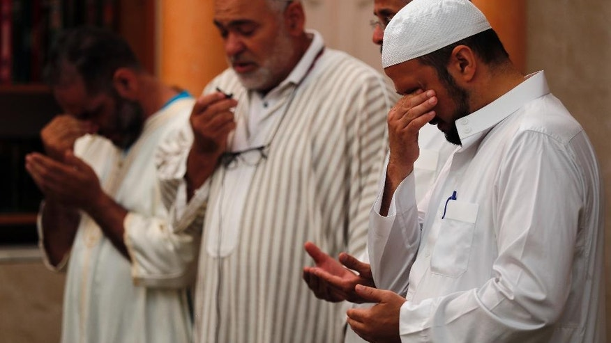 Imams held prayers for three of those killed in Thursday's attack, including 4-year-old Kylan Mejri and his mother Olfa Kalfallah, 31, at the ar-Rahma mosque in the eastern suburb of Ariane in Nice, southern France, Tuesday, July 19, 2016. Mourners rallied around Kylan's father, Tahar, who spoke of his grief at losing his son and wife in the attack. (AP Photo/Francois Mori)