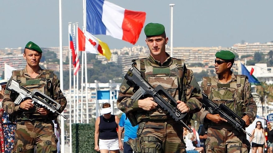 Soldiers patrols on the Promenade des Anglais in Nice, southern France, Tuesday, July 19, 2016. Joggers, cyclists and sun-seekers are back on Nice's famed Riviera coast, a further sign of normal life returning on the Promenade des Anglais where dozens were killed in last week's Bastille Day truck attack. (AP Photo/Claude Paris)