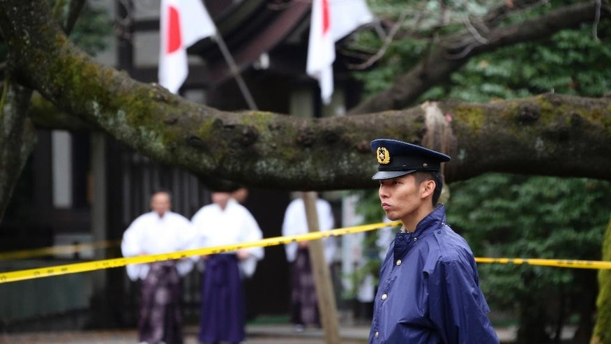 FILE - In this Nov. 23, 2015, file photo, a police officer stands guard Yasukuni Shrine in Tokyo following an explosion in its public restroom. South Korean Jeon Chang-han, who detonated a homemade device in the public restroom, was sentenced to four years in prison on Tuesday, July 19, 2016 in Tokyo District Court. He was arrested in December and charged with trespassing, property damage and violation of the explosives control law. (AP Photo/Koji Sasahara, File)