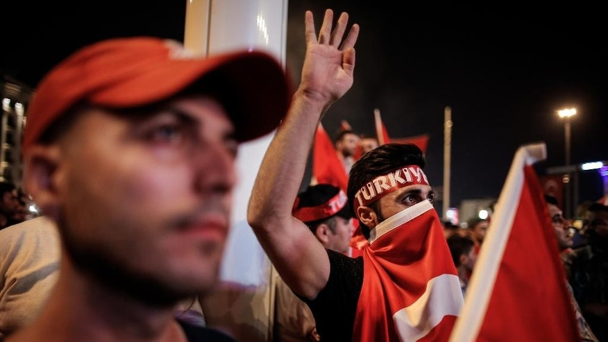 People wave Turkish flags as they gather in Taksim Square in Istanbul, protesting against the attempted coup, early Tuesday, July 19, 2016. The Turkish government accelerated its crackdown on alleged plotters of the failed coup against President Recep Tayyip Erdogan. The rebellion, which saw warplanes firing on key government installations and tanks rolling into major cities, was quashed by loyal government forces and masses of civilians who took to the streets. (AP Photo/Emrah Gurel)
