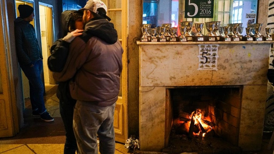 In this July 16, 2016 photo, trophy cups are displayed on a fireplace mantel during the fifth annual Cannabis Cup, a competition for best marijuana, in Montevideo, Uruguay. All the competitors received a jar with samples from others in the best marijuana tournament and were allowed to taste some of the finest pot in the South American country. (AP Photo/Matilde Campodonico)