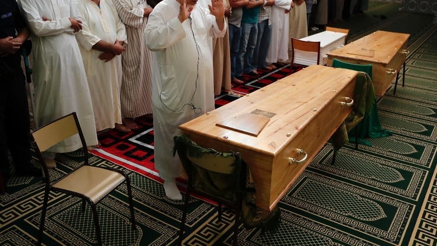 Imams and worshipers held prayers for three of those killed in Thursday's attack, including 4-year-old Kylan Mejri and his mother Olfa Kalfallah, 31, at the ar-Rahma mosque in the eastern suburb of Ariane in Nice, southern France, Tuesday, July 19, 2016. Mourners rallied around Kylan's father, Tahar, who spoke of his grief at losing his son and wife in the attack. (AP Photo/Francois Mori)