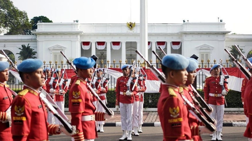"In this Sunday, July 17, 2016 photo, members of Presidential Security Forces stand in attention during the changing of guard at Merdeka Palace in Jakarta, Indonesia. Indonesian authorities banned the playing of ""Pokemon Go"" from the presidential palace on Wednesday, July 20, 2016, as they voiced worries that the game could be a security risk. (AP Photo/Dita Alangkara)"