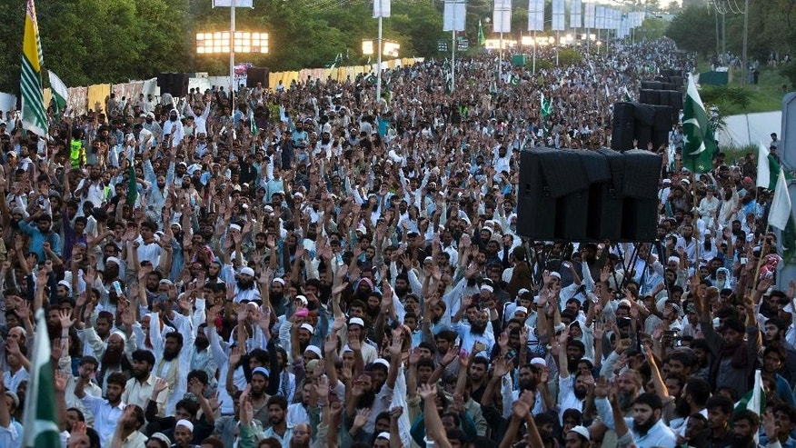 "Supporters of Pakistan's religious group Jamaat-ud-Dawa raise their hands during an anti-Indian rally to express solidarity with Indian Kashmiris, in Islamabad, Pakistan, Wednesday, July 20, 2016. Pakistan Prime Minister Nawaz Sharif vowed that his country would continue extending political moral and diplomatic support to Kashmiris. He urged his countrymen to observe ""black day"" to express solidarity with ""Kashmiris who are facing atrocities at the hands of Indian forces."" (AP Photo/B.K. Bangash)"