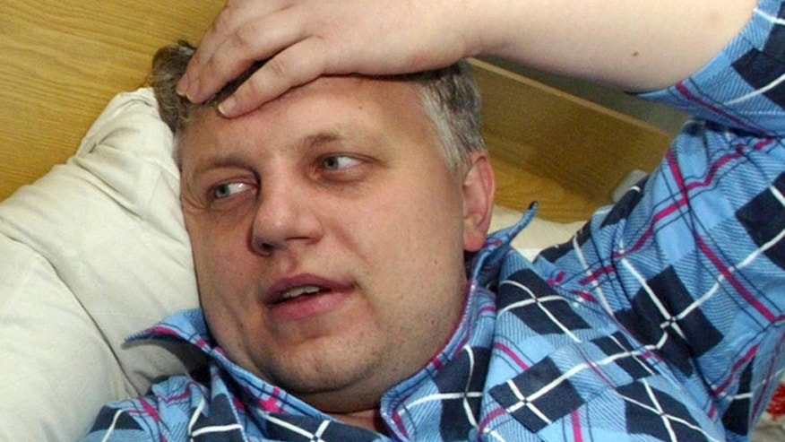 FILE - In this Oct. 18, 2004, file photo, journalist Pavel Sheremet speaks at a hospital in Minsk, Belarus, after he was found badly beaten. The 44-year old Belarusian-born prominent journalist was killed in a car bombing in Ukraine's capital, Kiev, on Wednesday, July 20, 2016. (AP Photo/Sergei Grits, File)